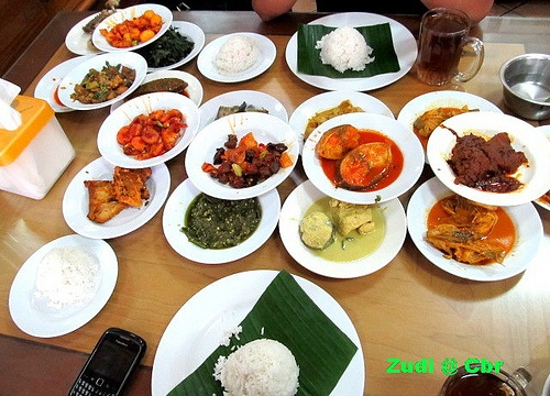 Padang Food-a variety of dishes are brought to your table and you pay for what you eat.