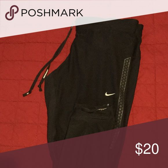 Nike running pants Nike running pants with dri-fit material. Size large. Zippers on the back calfs on both sides. Black. Design on the sides. Two large, one medium. Same exact pant. 92 % polyester and 8% spandex Nike Pants Track Pants & Joggers