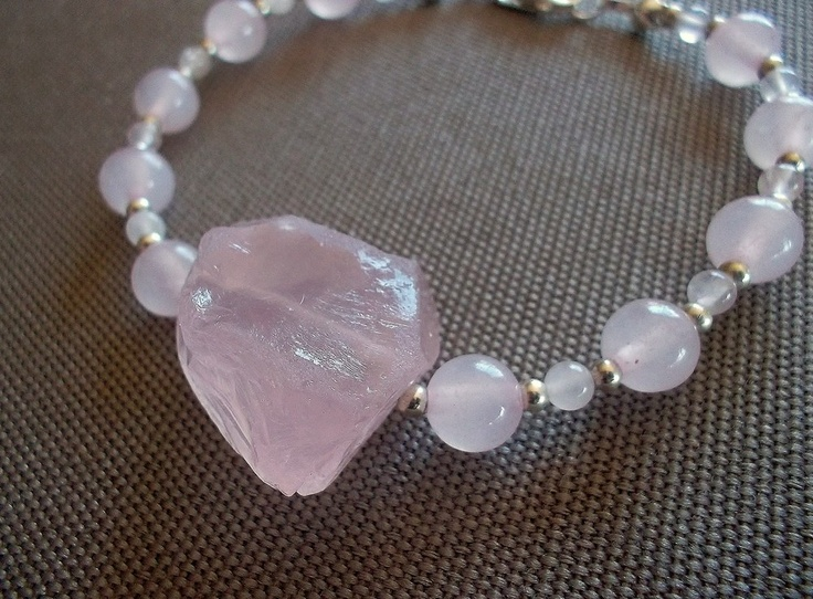 Handcrafted bracelet featuring 2mm and 6mm genuine rose quartz beads, and a 22mm genuine rose quartz feature bead. Sterling silver beads and clasp, total bracelet length is 8 inches.