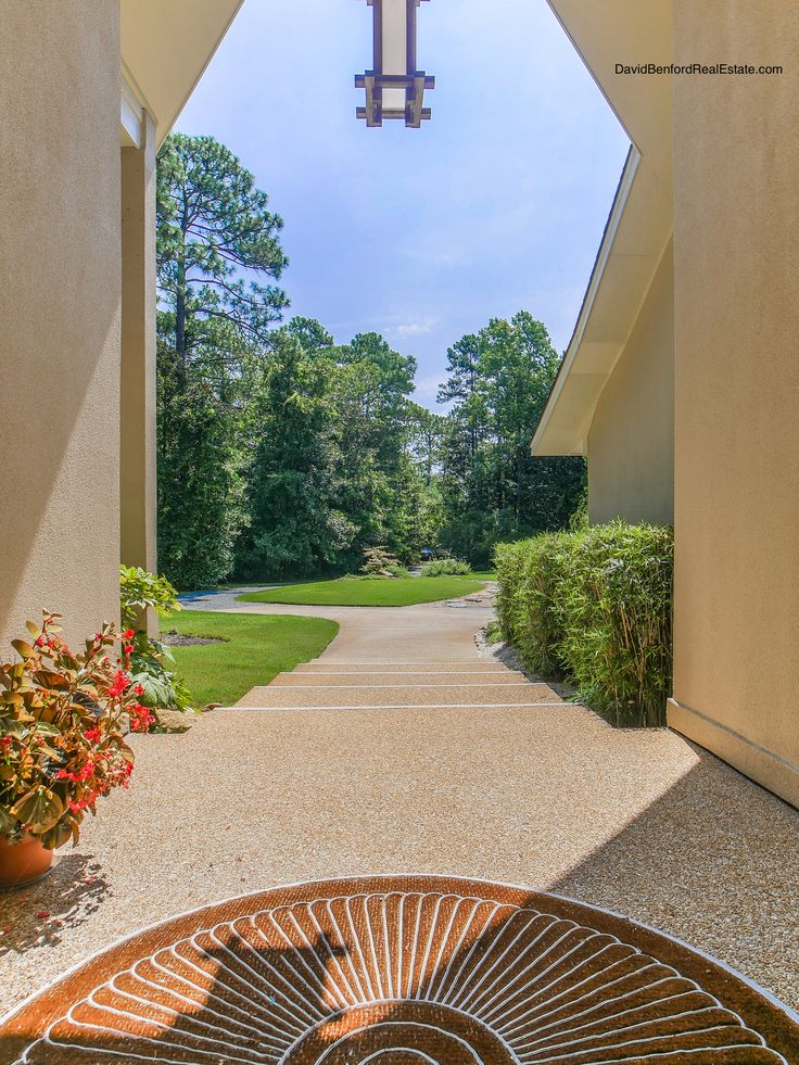 7211 Masonboro Sound Rd Wilmington, NC is a unique contemporary retreat on  over 3 acres