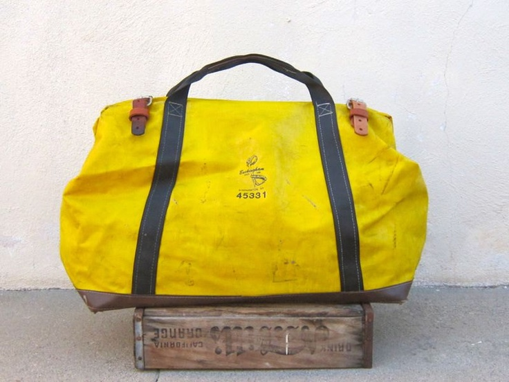 Yellow Coated Canvas and Black Trim Lineman Tool bag by Buckingham Manufacturing.