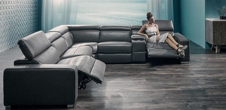 100% Leather modular range. Features electric recliners, drinks holder with storage console.