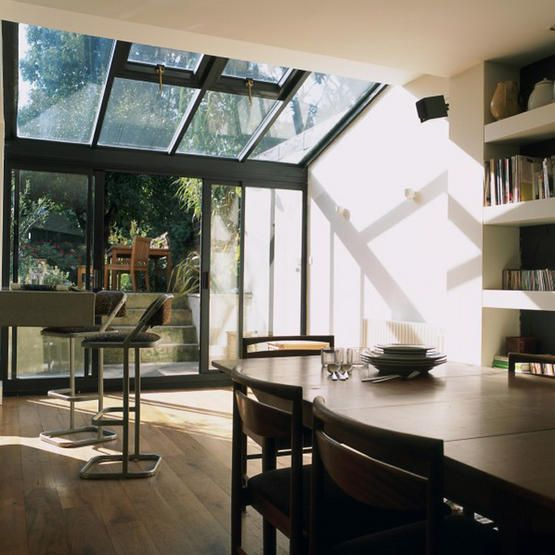 kitchen extension with glass walls and ceiling