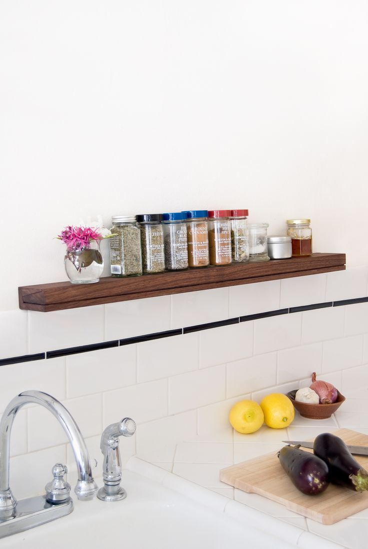 SINGULAR wall console's modern minimalist style works perfectly as it's used as a spice shelf in this classic white kitchen.  |  singularconsole.com
