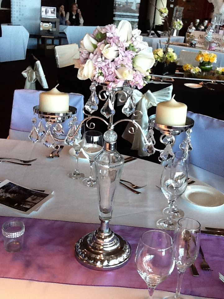 glass candelabra with floral arrangement by www.newminsterfinctiondesign.com