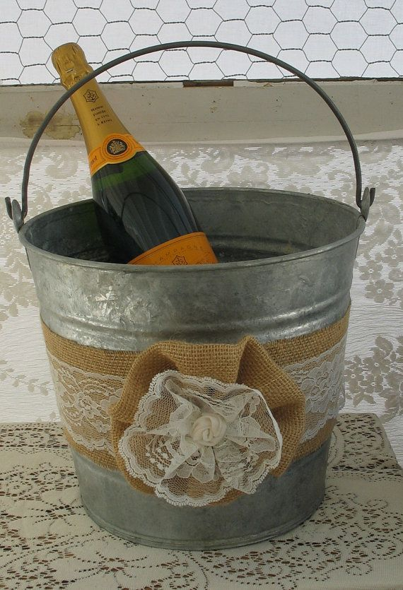 Champagne Bucket  - Burlap and Lace use with citranella candles inside for centerpieces put other candles around them 2/table with daisies in middle for splash of color