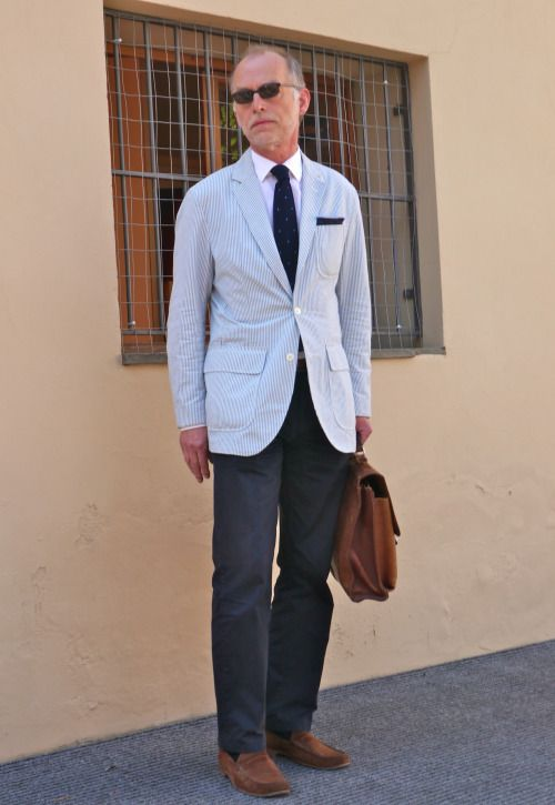 Seersucker jacket, white shirt, navy tie, navy pants