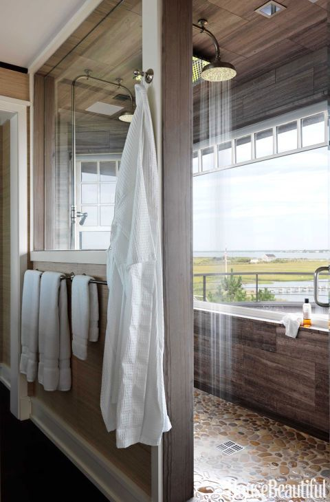 A six-by-nine-foot master bathroom shower has two Waterworks Easton Classic showerheads and stunning bay views. An interior window opens up the whole bathroom to sunlight and the views.