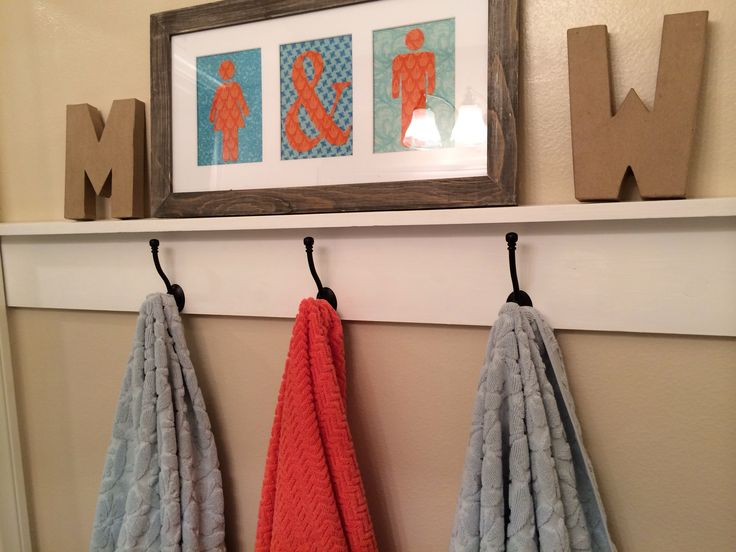 Boy and Girl Bathroom Design- love the men and women symbols for the door  cool idea for framing 3 images that go together...