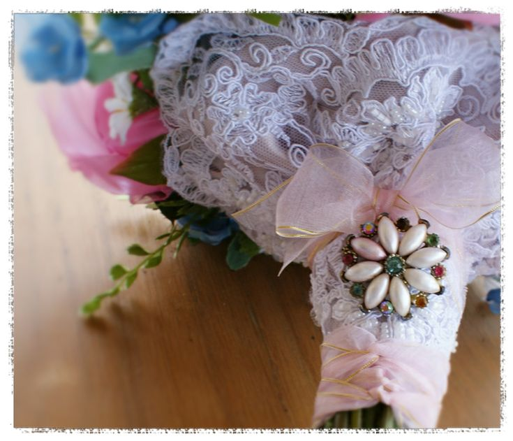 wedding bouquet for Michelle - beaded bridal lace over pale coffee satin ribbon for the underside and top of the handle, finished with vintage pink georgette ribbon edged in gold and a vintage brooch