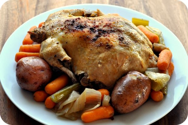oil mixture and add to slow cooker.  Add vegetables to slow cooker.  Pour 1/2 the chicken broth over the vegetables.  Cook on low for approximately 6 hours. Add more chicken broth as needed.  Remove chicken from slow cooker and place on a baking sheet under oven broiler on low for about 5 minutes (crisps the skin).