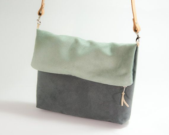This cute fold over purse is made of a gray and opal microfiber suede fabric. The interior is a white cotton with polka dots.