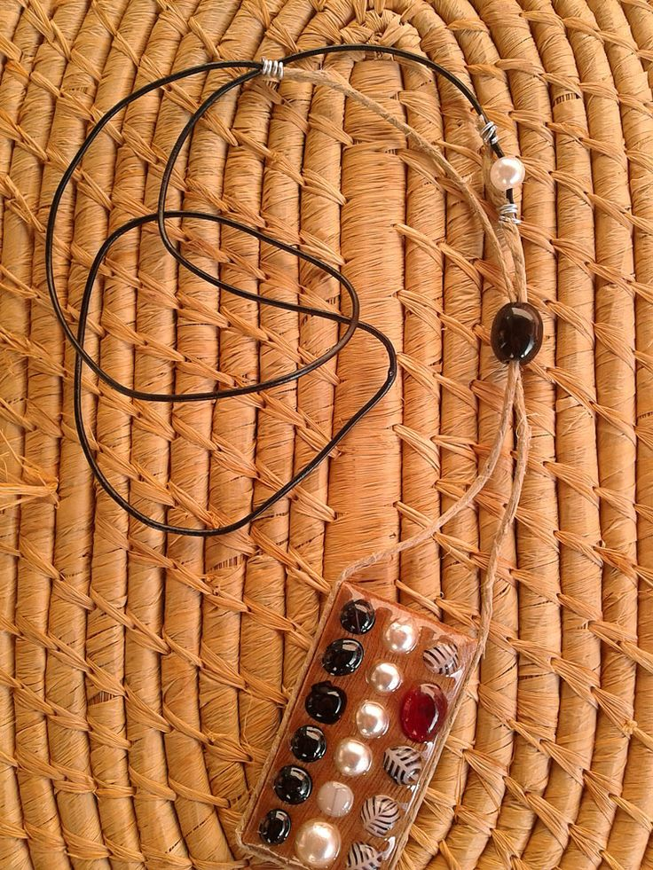 Wooden long necklace with black, white, grey and red beads.
