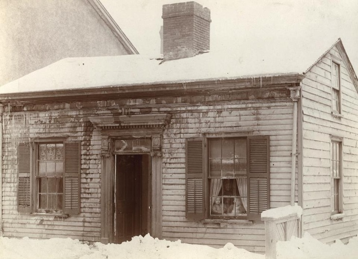 The figures in the window add a special touch to this 1890s winter photo of the west side of Bay St. south of Albert St., Toronto. #Canada #winter #snow #Victorian #house #1800s