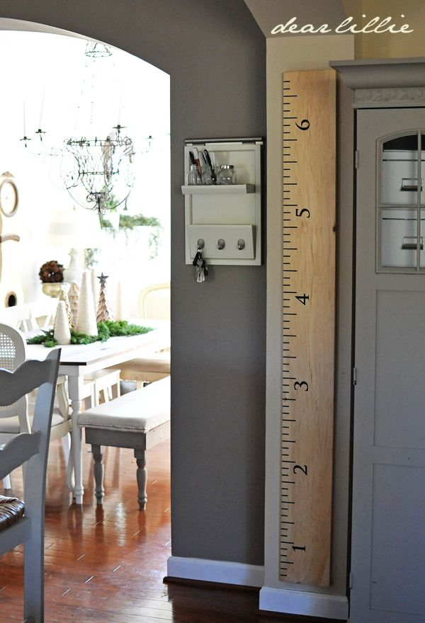 Turn a 2x4 price of ply wood into a ruler to use as a growth chart for your kids!