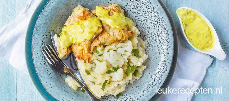 Heerlijke combi van smeuige stamppot met een stukje vis met amandelkorst en kerriesaus