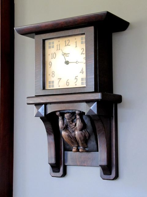 Craftsman style clock made with a reproduction Batchelder corbel. Figured out where you can buy it: http://www.present-time-clocks.com/product/dutch-chocolate-wall-clock/
