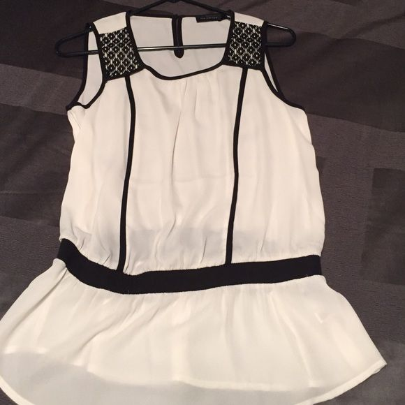 Black and white shirt Never worn. Size small. Gathered waist black and white sleeveless shirt. Can be formal or causal The Limited Tops