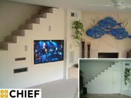 television / media storage under stairs