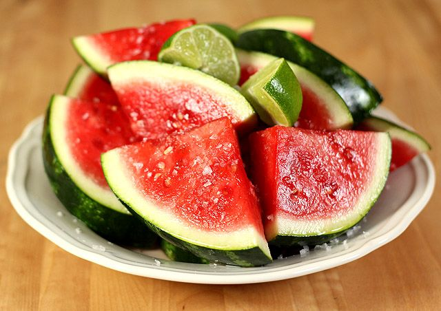 "Margarita Watermelon:  For a yummy ""cocktail"" you can eat, soak watermelon wedges in tequila and sprinkle on coarse salt. Garnish with lime wedges.  These edible ""watermelon margaritas"" will sure to have your guests talking."