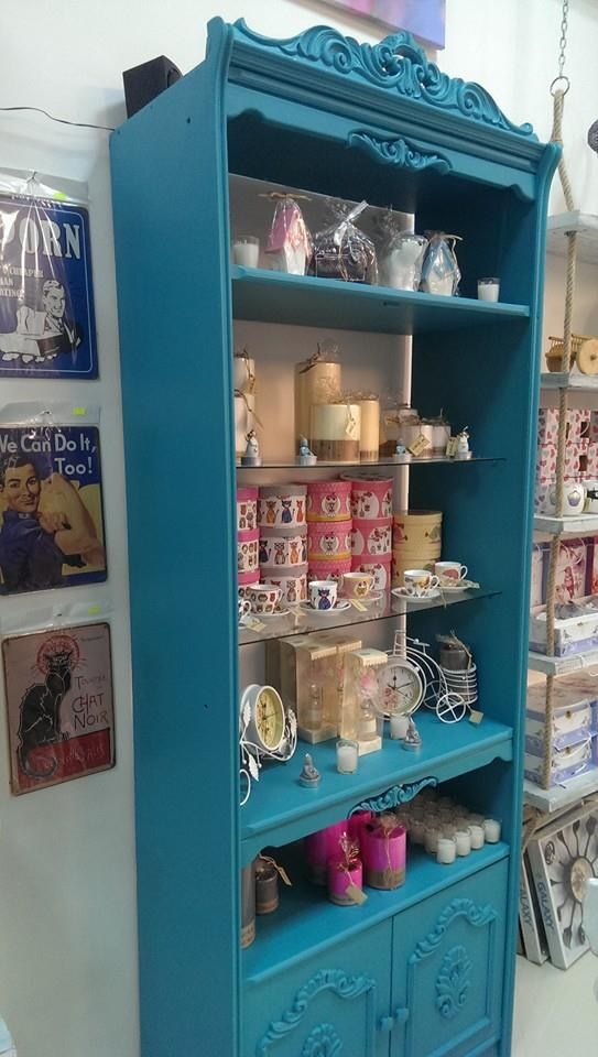 A vintage cabinet we restored and painted teal blue for our Store