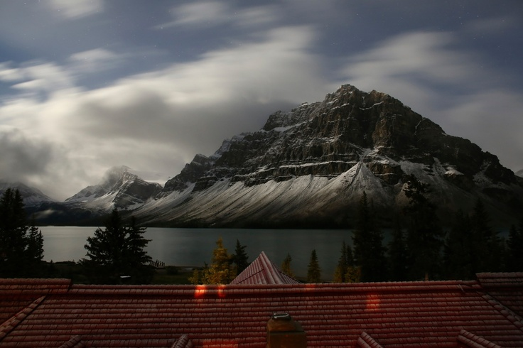 Num-Ti-Jah Lodge, Lake Louise, Alberta, Canada. A breathtaking view of Bow Lake and Crowfoot Mountain past the roof of the lodge. Courtesy of Mark Derry Photography www.markderry.com