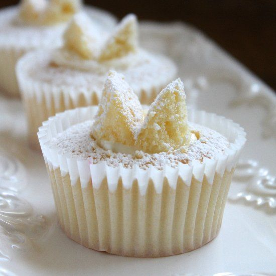 Elegant, light and dainty, these cupcakes are filled with raspberry jam and fresh cream and look as if they have little butterflies on top.