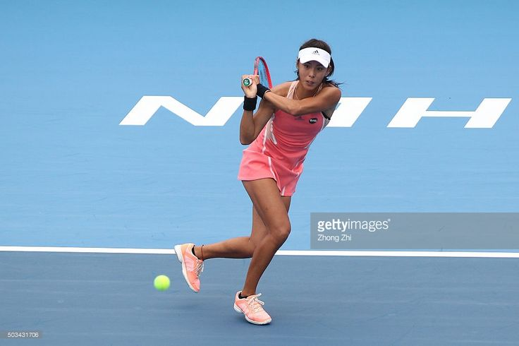 Qiang Wang of China returns a shot during the match against Johanna Konta of Great Britain during Day 3 of 2016 WTA Shenzhen Open at Longgang Sports Center on January 5, 2016 in Shenzhen, China.