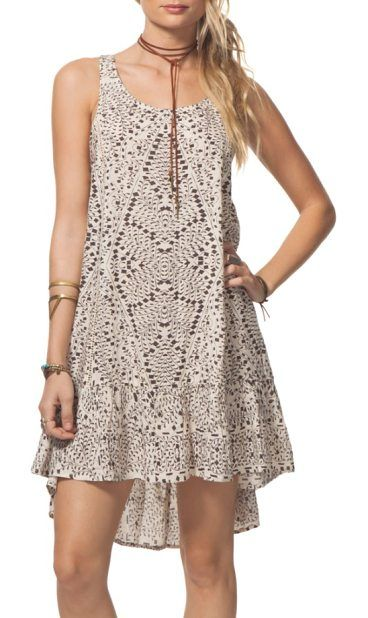 sun shadow print swing dress by Rip Curl. A confetti-like geo print adds playful embellishment to this swingy high/low sundress styled with ladder-stitched str...