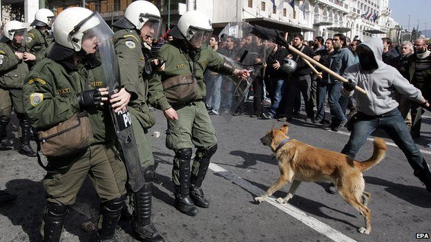 Loukanikos confronting riot police in Athens, 2011 - file pic. Famous Greek riots dog dies.