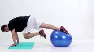 Príťahy a vystieranie jednej nohy vo vzduchu v planku na jednej nohe na fitlopte