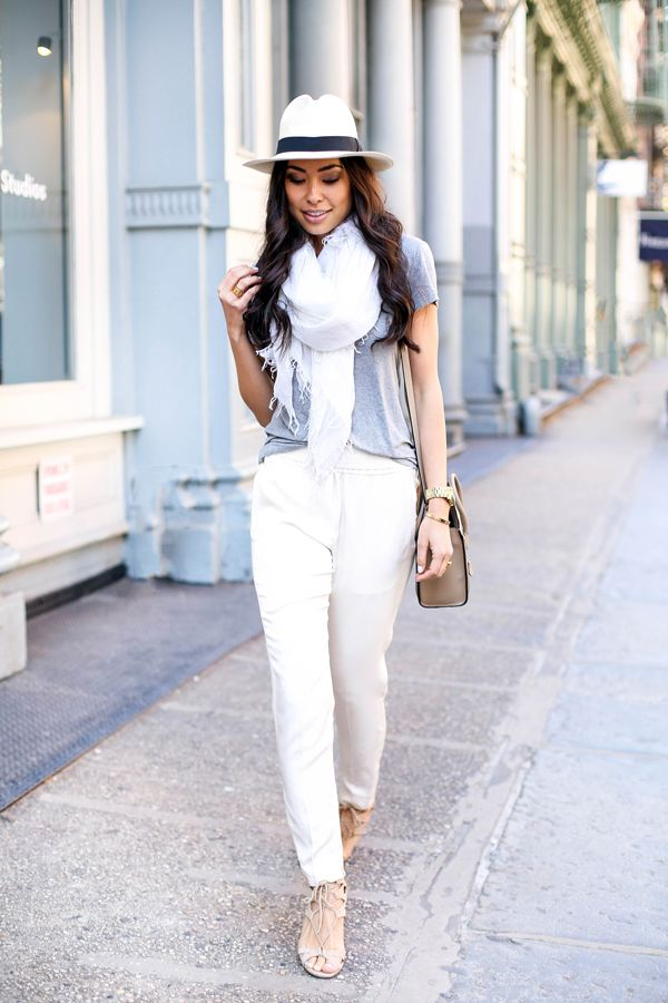 Cream silk pants with lace up heels.