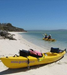 Sea Kayaking - Gravity Adventures. Sea kayaking and accommodation at Indio Blue beach house. A perfect place to escape the city. Combine with the adventure of exploring the West Coast National Park. Day trips and kayak hiring also available.