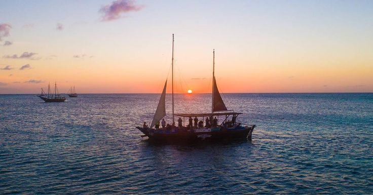 The sun sets across pirate ships of a bygone era off the coast of Aruba. I took the quadcopter on a long flight to find this... barely got back home before the battery died! #pirateship #piratesofthecarribean #rcmemories #ritzcarlton #aruba @ritzcarlton