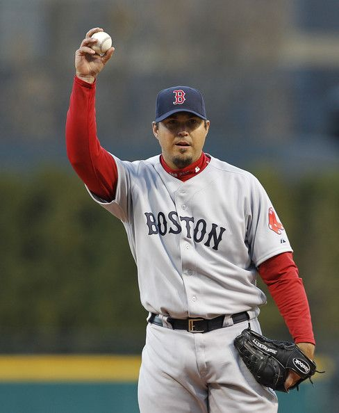 Josh Beckett   Josh Beckett Josh Beckett #19 of the Boston Red Sox warms up prior to ...