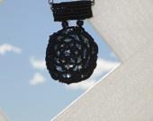 Slider pendant with beaded bezel. Beautiful sun-catching effect!