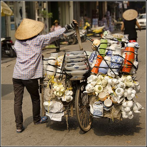 Mobile Shop. A crockery vendor in Hanoi, where most goods can be bought from a bicycle.