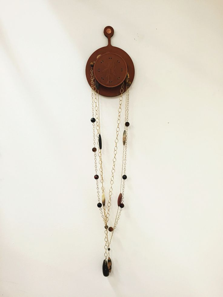 Leather necklace holder available at Millworks