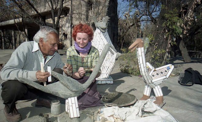 Nek Chand turns 90 - Nek Chand showing how to create sculptures to a tourist at Rock Garden in #Chandigarh. #IndiaMarketHub