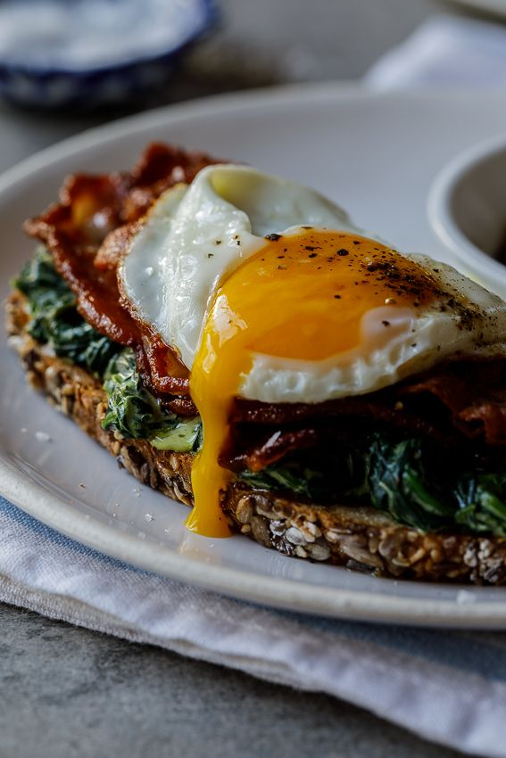 Bacon, egg and creamed spinach breakfast toast - Simply Delicious. Breafkast   Brunch   Gluten free   Easy recipe   Food   cooking   Food styling   Food photography   Fried egg   Easy breakfast   See more http://recipesheaven.com/paleo
