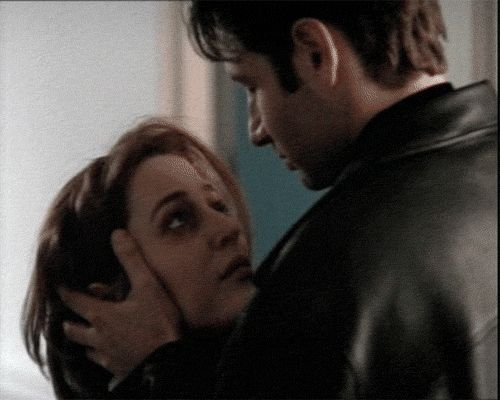 "Gif of deleted kiss between Mulder and Scully from Memento Mori.  ""There were obvious reasons for deleting the first kiss on the lips between Mulder and Scully. It wasn't scripted and the actors decided to give it a try."" - Chris Carter"