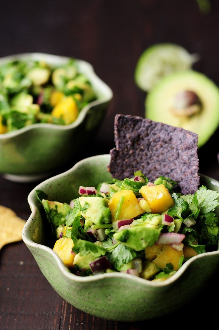 Refreshingly tasty mango avocado salsa that's a crowd-pleasing snack or appetizer with tortilla chips and it's amazing as a topping for seafood. #paleo #vegan #glutenfree