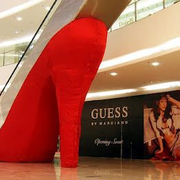 High heel escalator in shopping centre