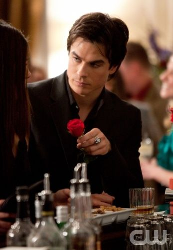I love how Damon gives Elena this rose so subtly and sweetly and she takes it. This is season one (1x18) before she acknowledges her love for him.