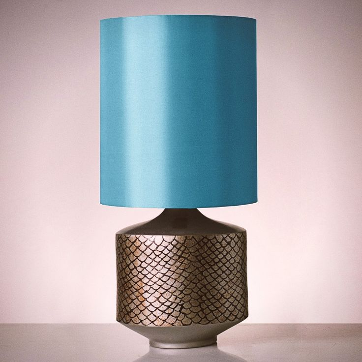 With a hand-drawn fish scale texture on its base, this Fish table lamp would fit the corner table of your beachfront living room perfectly! #pimentrouge #bali #lighting #lamps #homedecor #interior #design #styling #blue #harmony #bythesea #beachfront #seashore #islandlife #tropical #paradise #getaway #seaside #blue #ocean #fish