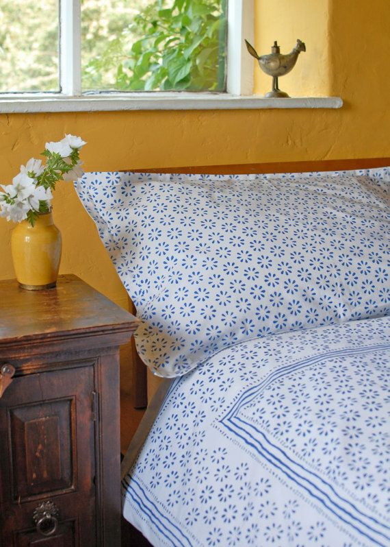 Organic Cotton Duvet Covers and Pillowcases - Blue on White Chukri design hand block printed on organic cotton. ** The Chukri in stock currently has NO BORDER (as seen in picture 1) but is still the same beautiful pattern**  Single Duvet Cover 135cm x 198cm (54 x 78) Double Duvet Cover 198cm x 198cm (78 x 78) King Duvet Cover 218cm x 223cm (86 x 88) Super King Duvet Cover Pillowcases also available. Our tiny workshop in Rajasthan has been producing duvet covers and pillowcases for us for…