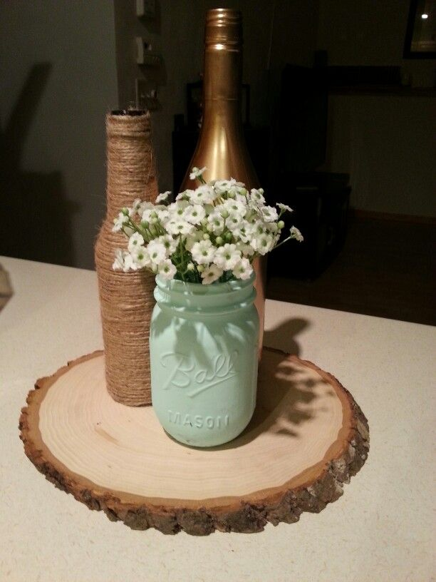 The 25 best beer bottle centerpieces ideas on pinterest for Painted wine bottle wedding centerpieces