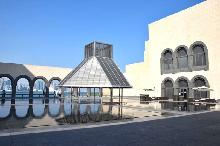 The courtyard of the Museum with views of Doha's Cornice, downtown and a calming reflective pool.