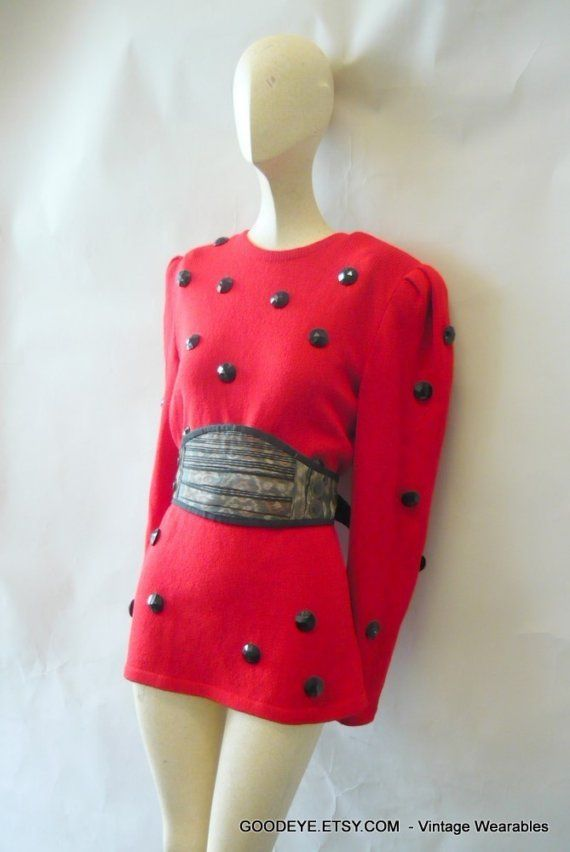 This is a bold 80s era, square shouldered sweater, in Lipstick red with giant black beads. It has long sleeves and a back zipper, made with a weighty wool blend with stretch. It was made by a well known label from the period. ( see details blow)  Vintage label: Raul Blanco - Hand loomed