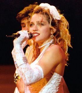 Madonna's 80s fashion. I remember how fun it was to get ready to go out and party with my girlfriends. .it was like playing dress up!  Im SO GLAD I experienced the 80's
